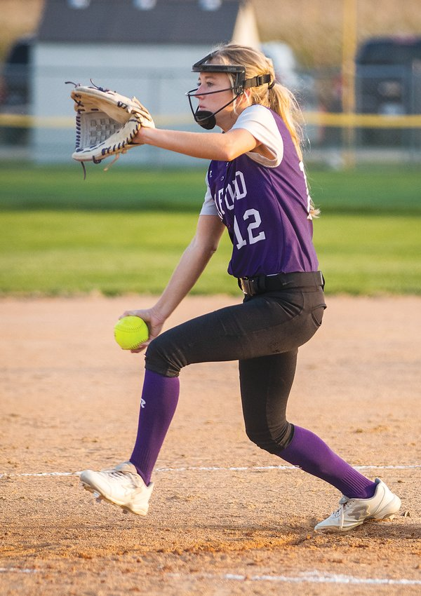 Makena Stutzman of Milford winds and delivers against Crete Sept. 22.