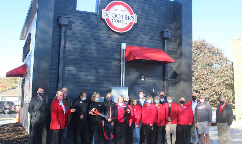 Members of the City of Seward, Seward County Chamber and Development Partnership, Jones Bank, Petsource, Bottle Rocket Brewing Company and Scooter's Coffee cut the ceremonial ribbon to the new business on Oct. 30.