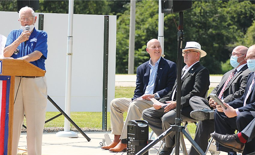 Marv Taylor, Seward Kiwanis Parade of Flags Advisor, acts as emcee for the Aug. 22 dedication of the United States Space Force flag and re-dedication of the POW-MIA flag at the Seward Parade of Flags. Sitting behind him are, from left, Gov. Pete Ricketts, State Sen. Mark Kolterman and Nebraska Sorghum Producers Association Executive Director Nate Blum.