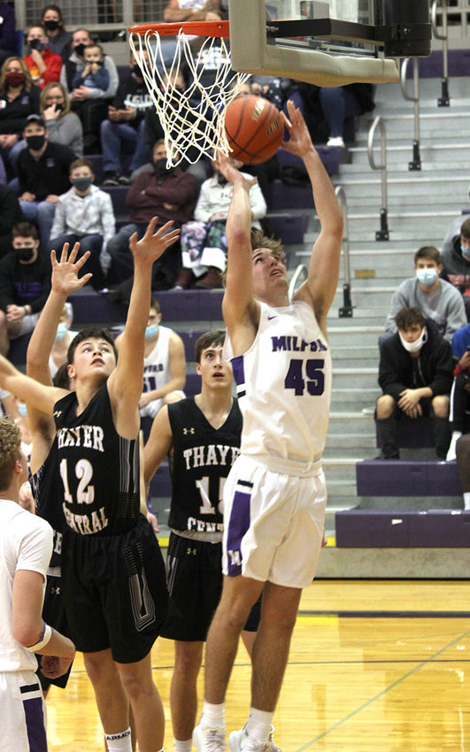 Cabe Schluckebier, a Milford High School junior, takes a shot in the Eagles' game Jan. 16 with Thayer Central..