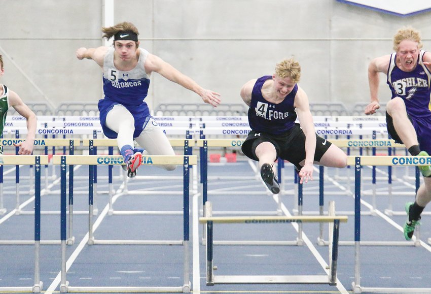 Will Saunders of Centennial edged Collin Piening of Milford in the 60-meter hurdles March 19 at the Bulldog Challenge.