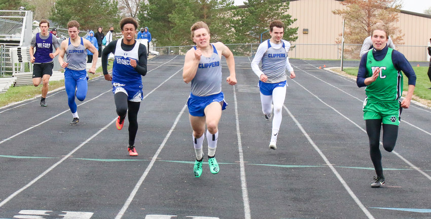 Malcolm's Dillon Beach powers to the finish line in the 400-meter dash April 7, beating, from left, Rollin Roth of Milford, Gavin Zoucha of Malcolm, Rayshun Foreman of Centennial, Colby Sizemore of Malcolm and Will Wenz of Wilber-Clatonia.