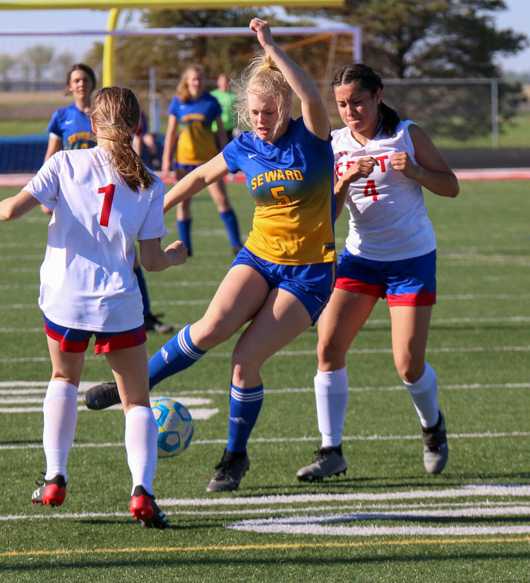 Seward's Claire Geidel controls the ball against Crete during the opening round of postseason play May 1.