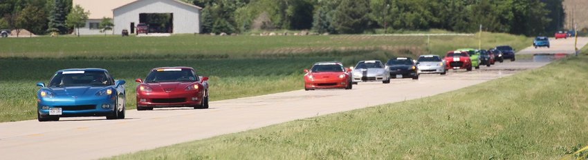 """Drivers participating in the Big Blue Mile Shootout June 4 trek back to the starting line for another trip down """"The Fastest Mile in Seward County."""""""