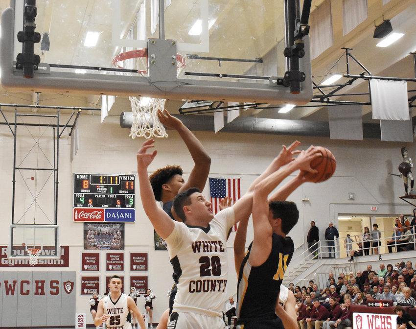 Micah Webster going up for rebound vs. Walker Valley