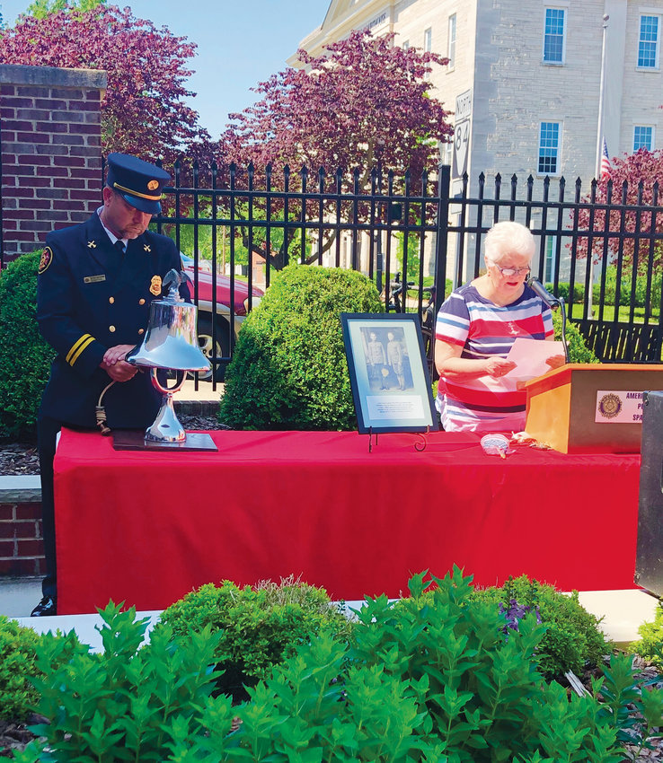 Soldiers' names were read while Jessie Buttrum rang a bell once for each name, while Mary Dingwall read part of the names of the World War II veterans. (Photos by RACHEL AUBERGER)