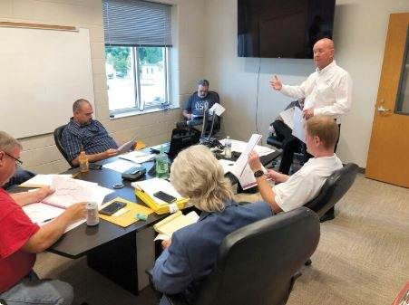 Jason Mumpower, deputy comptroller for the Tennessee Comptroller of the Treasury, explains to Van Buren County Board of Commissioners the seriousness of the county's financial situation during Tuesday night's meeting.