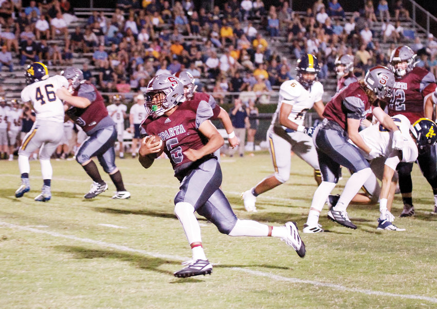 Jayden Richmond is shown during last year's football season as the Warriors took on Walker Valley. The 2020 football season will have stricter guidelines for fans to protect them from COVID-19.