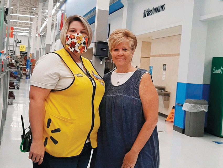 Carleen Benson, Backpack Assist Ministry organizer (right), poses with Walmart employee Amanda after the corporation donated $1,500 to B.A.M.