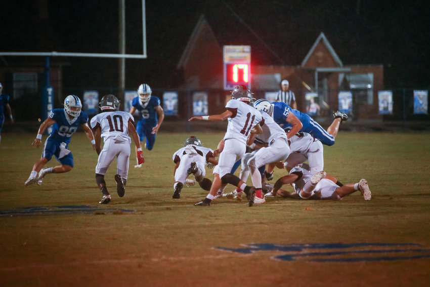 A host of Warriors attempt to recover an onside kick against Macon County. ( Photo provided by JULIA MORRIS PHOTOGRAPHY)