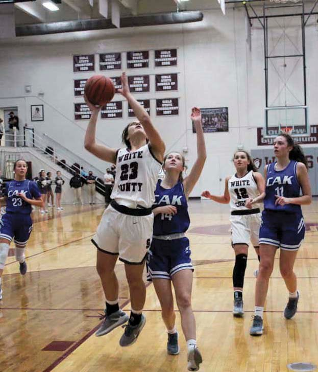 Celeste Reed goes up strong to the basket as Nia Powers trails during action against Christian Academy at Knoxville, at the Nov.19 game, at Sparta