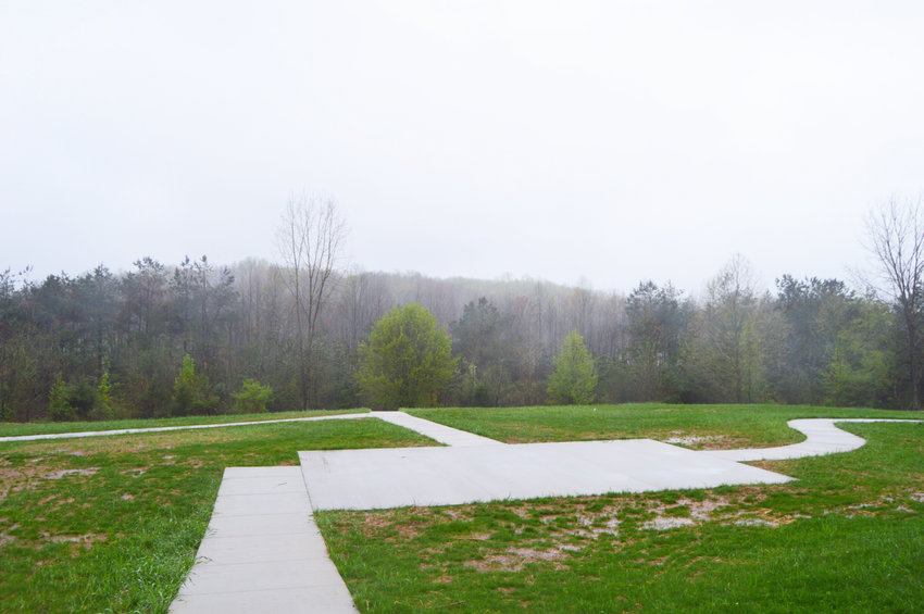 Sidewalks are complete for the 1.5-acre dog park being constructed at Cane Creek Park. The park will include shade structures, fencing, dog agility equipment and more.
