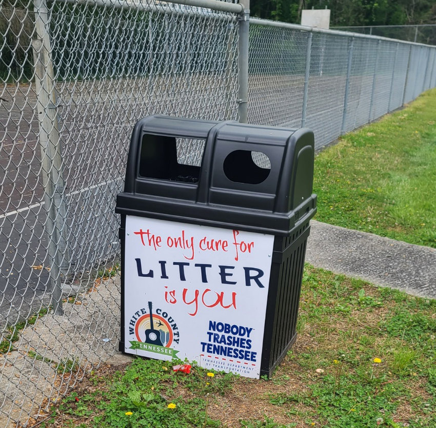 Trash receptacles had been placed at the high school, one being chained near the tennis courts and the other near the outdoor basketball courts. The receptacles were purchased through a Litter Grant.