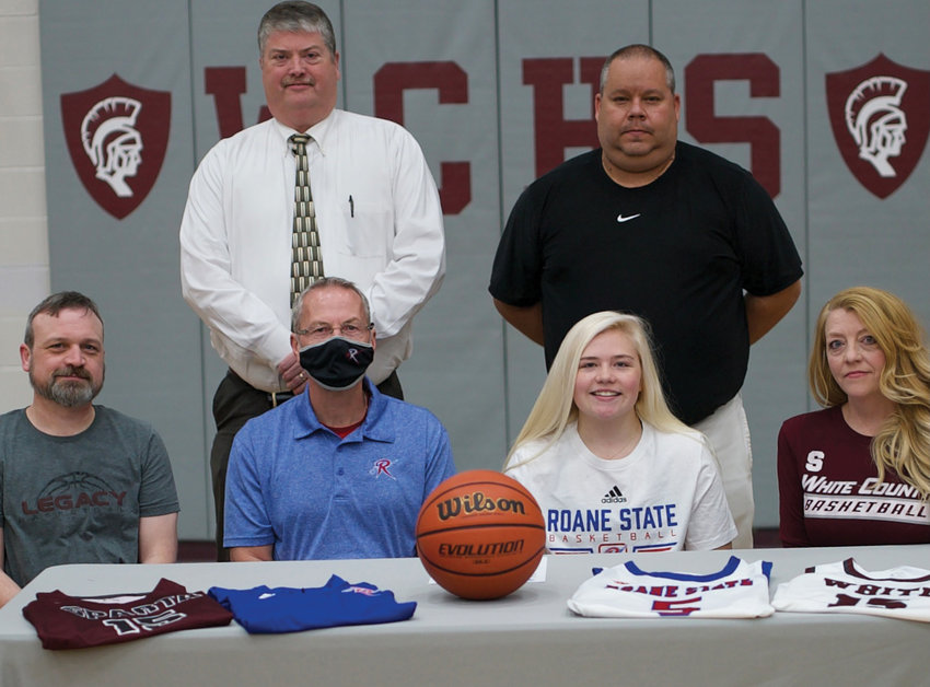 (Front row) Addison Frazier is pictured with her parents and a representative from Roane State. (Back row, L-R): Greg Wilson, White County High School principal, and Michael Dodgen, WCHS girls' basketball coach.