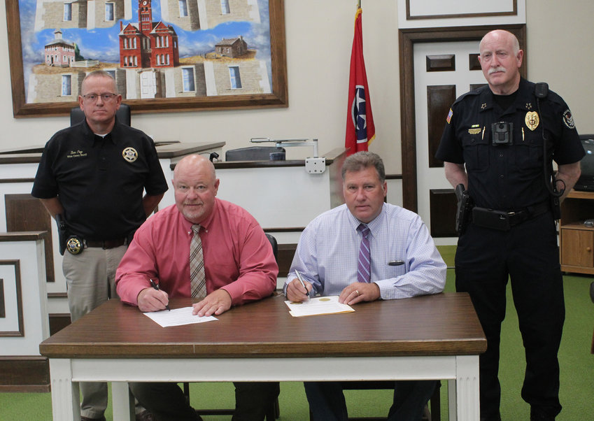 City and county officials recently gathered to sign a proclamation in observance of National Suicide Prevention Month. Seated, L-R: Denny Wayne Robinson, White County executive, and Jeff Young, City of Sparta mayor; back row, L-R: Sheriff Steve Page and Police Chief Doug Goff.