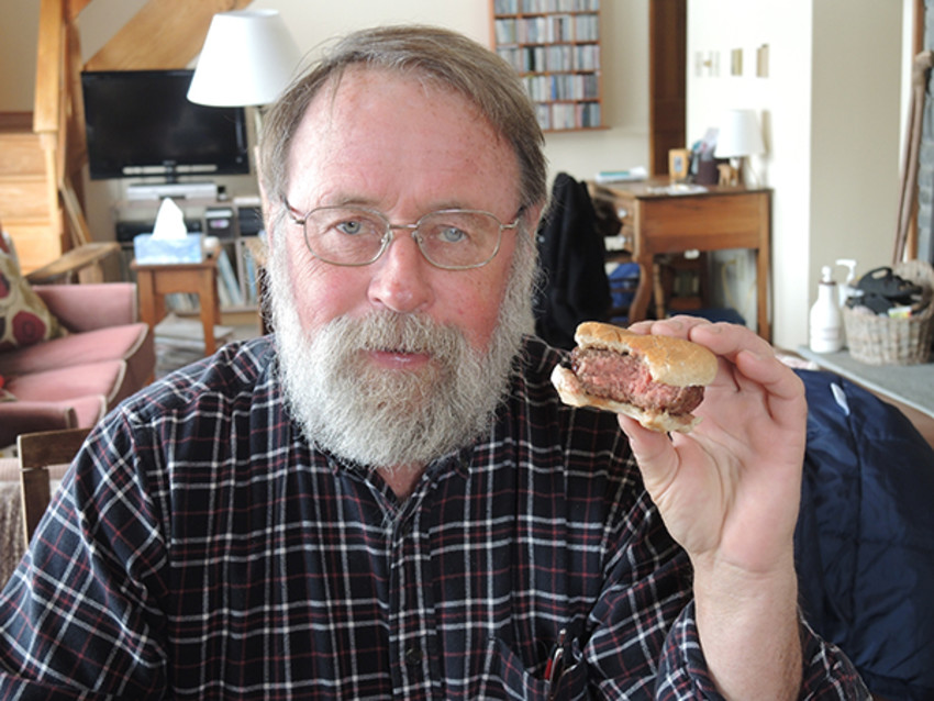 Photo by Sue Henninger.David Tregaskis enjoys a Black Angus burger as much as his customers do.
