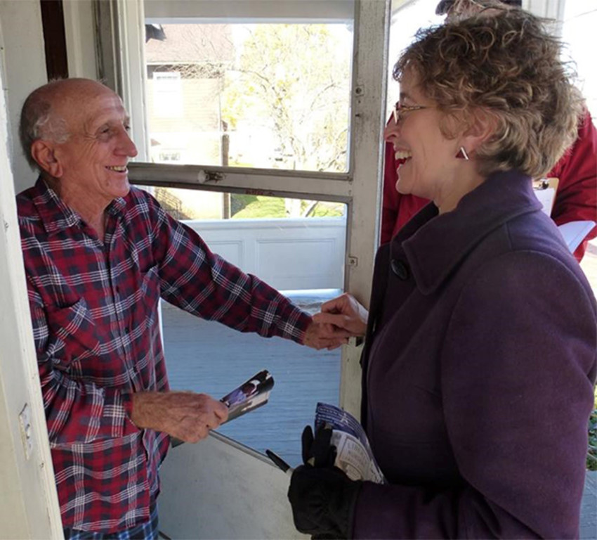 Photo ProvidedTompkins County Legislator Martha Robertson talks with a constituent while campaigning door to door.