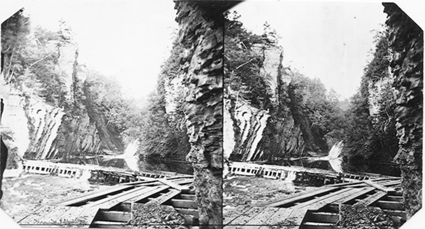 Photo provided by The History Center in Tompkins CountyDam and sluice-way to divert water to the Ezra Cornell tunnel. This 1867 view is taken from the mouth of the tunnel looking upstream. (Today it would show the Stewart Avenue bridge.)