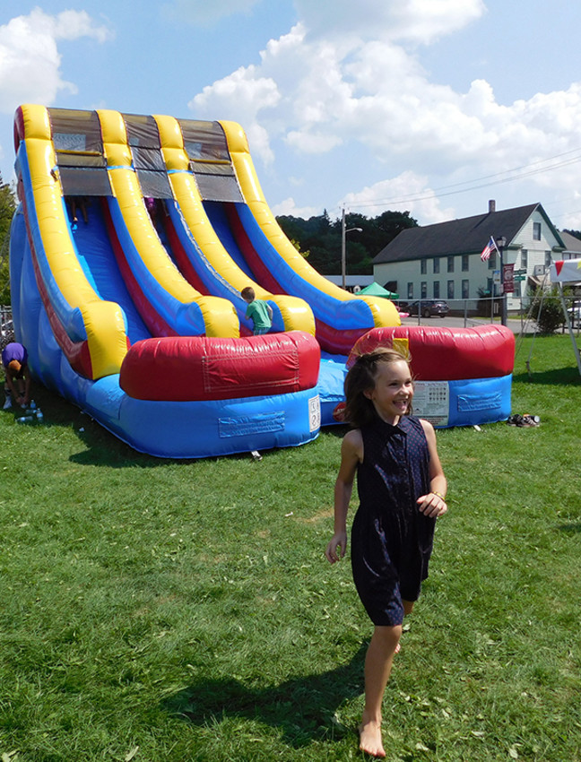 Photo by Kristy Montana / Tompkins WeeklyA festivalgoer shows their excitement after riding an inflatable slide at the Groton Olde Home Days celebration last year.