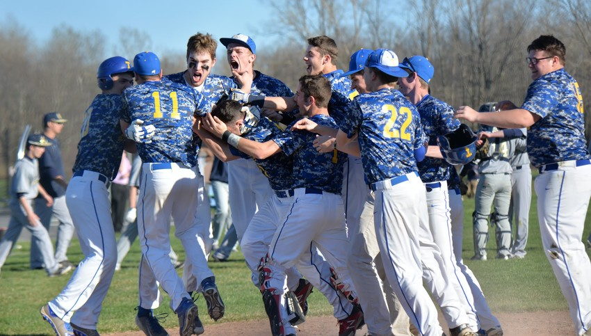 Members of the Trumansburg baseball team celebrate Zachary Ives' game-winning home run in an April 20 victory over Elmira-Notre Dame.
