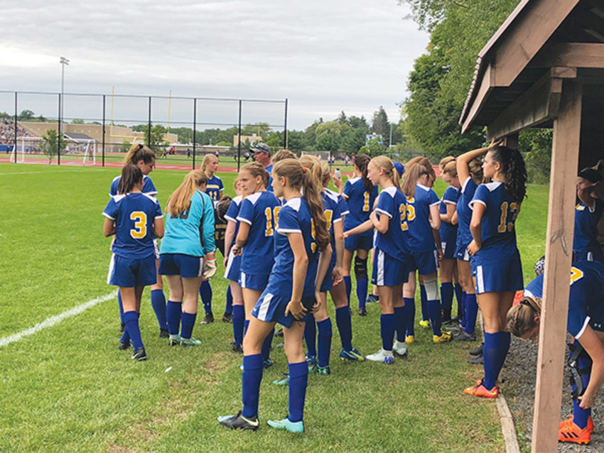 Photo by Mark Shelley.The Trumansburg Blue Raiders huddle up during a game against Dryden on Sept. 12. The young team isn't concerned with inexperience, they're just focused on getting playing time and winning together.