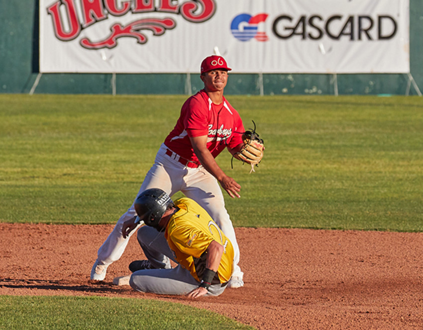 Photo by Alan Wintz.Lansing grad Ellington Hopkins (in red) in game action for the Alpine Cowboys.