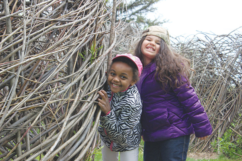 Photo provided by Ithaca Children's Garden. Students pause briefly from healthy, outdoor play at Ithaca Children's Garden during an environmental education and nature-play field trip last spring.