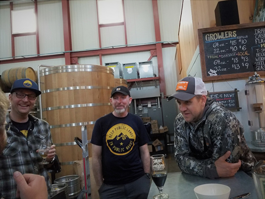 Photo by Cosmo Genova.Backcountry Hunters and Anglers members share stories and laughs at a pint night event.