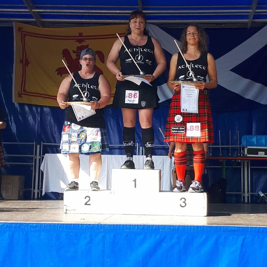 Courtney McGuire, far left, has been competing in the Highland Games for about seven years. This photo was taken from her recent competition in Stuttgart, Germany.