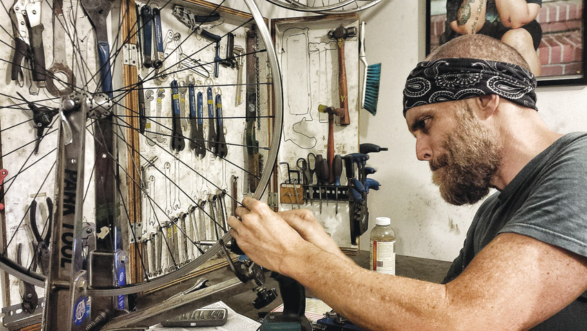 Matteo Wyllyamz worked on his second-hand bike for months, refurbishing and customizing it to be exactly what he needed, with the help and guidance of Recycle Ithaca's Bicycles.
