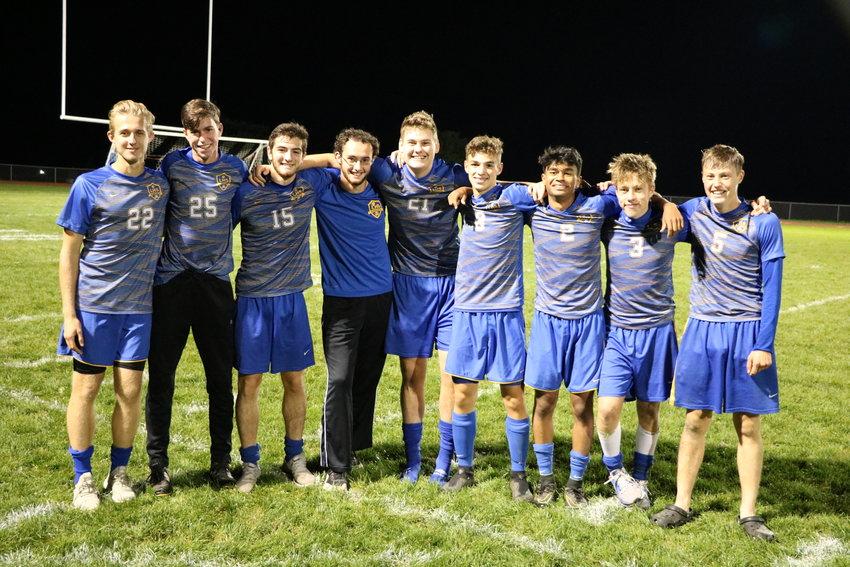 From left to right, this season's senior Bobcats: Philip Linnik, George Taylor, Aidan Huslebosch, Andrew Galvin, Matthew Kirkwood, Jason Littlefair, Langston Hopkins, Erik Goehler, Ethan Zemanick.