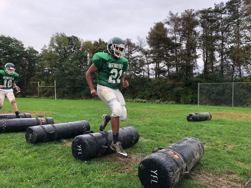 For Newfield, the move from 11-player to eight-player football is an opportunity for the athletes on the field to take advantage of more space. Above, Anthony Pawlewicz and Arthur Hardison at a recent Newfield practice.