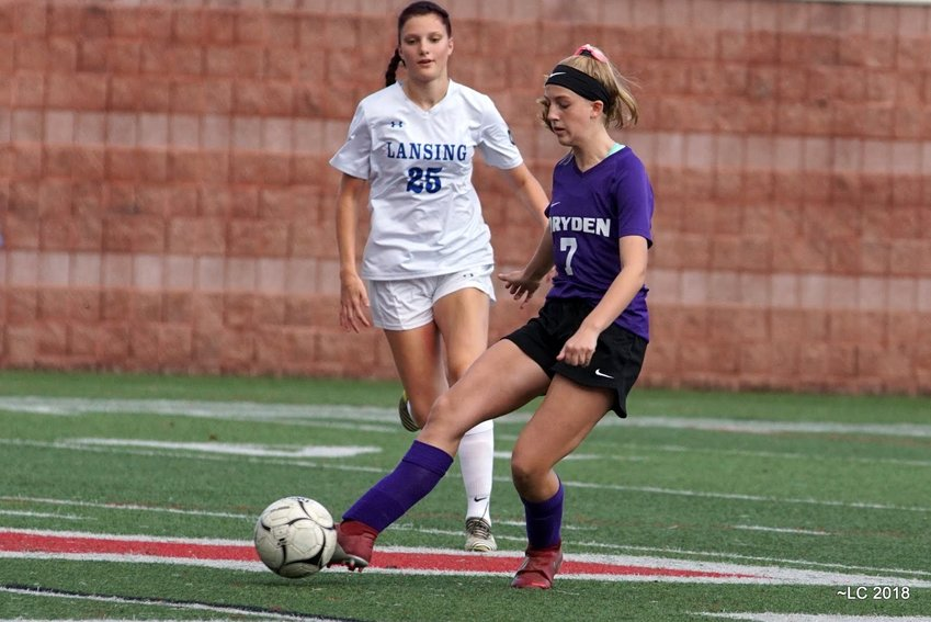 Ava Wilder, defender for the varsity Dryden Girls Soccer team, stays composed under pressure. The eighth-grader has shown tremendous talent this season.