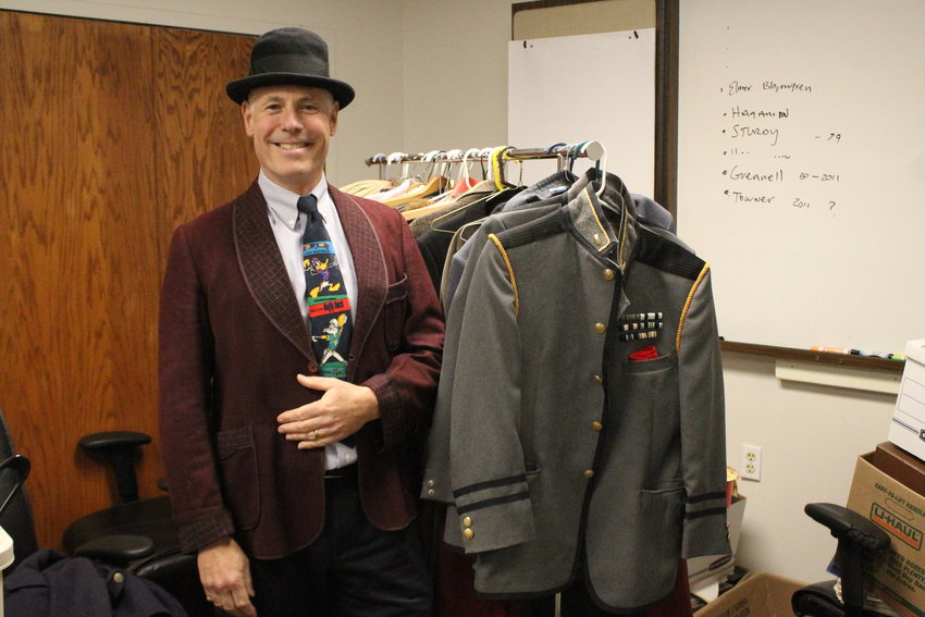CEO of the YMCA of Ithaca and Tompkins County, Frank Towner, gets into the spirit of the upcoming event by trying on some of the provided costumes that volunteers will be wearing at the dinner.