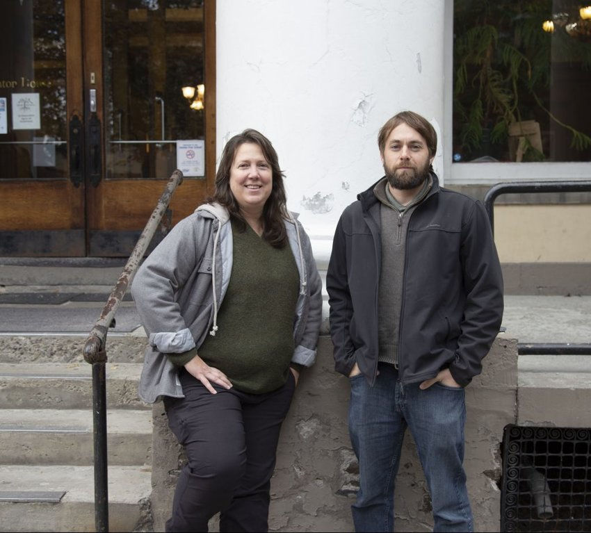 Becky Lane, left, and her co-creator Jacob Madden in front of the Clinton House building.