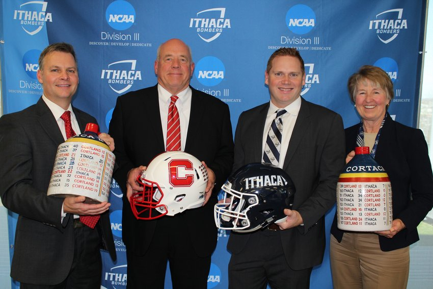Last week, school officials from both SUNY Cortland and Ithaca College announced that next year's Cortaga Jug game will be played at MetLife stadium in New Jersey. From left to right: Mike Urtz, SUNY Cortland Athletic Director; Dan MacNeill, SUNY Cortland football coach; Dan Swanstrom, Ithaca College football coach; and  Susan Bassett, Ithaca College Athletic Director.