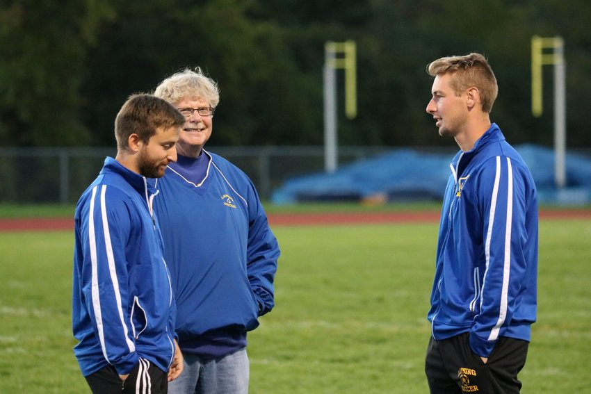 From left to right: assistant coach Andrew Troisi, assistant coach David Schlesinger, and head coach Benji Parkes.
