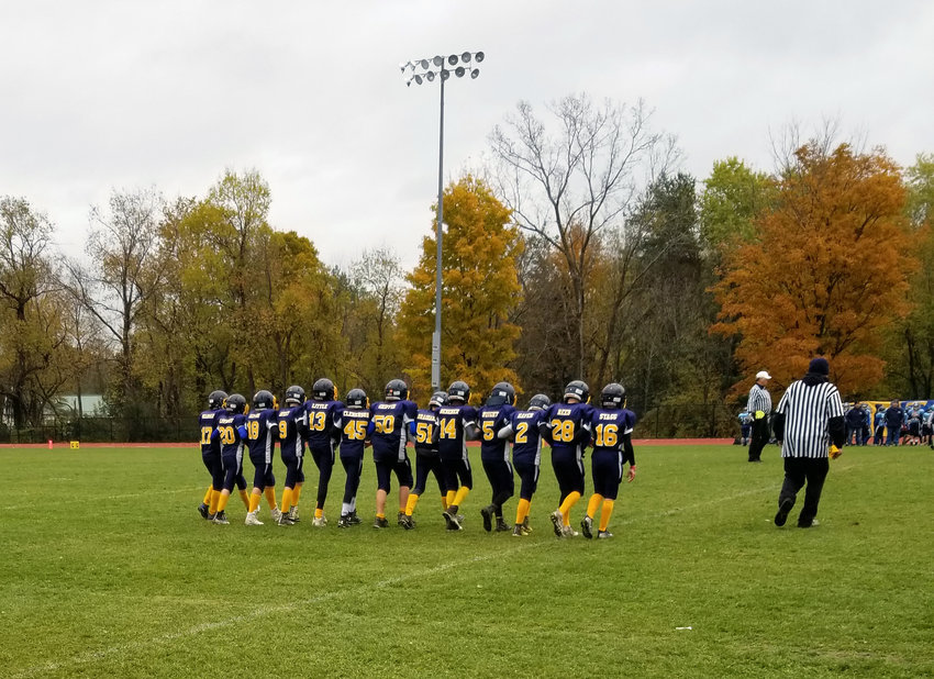 The Trumansburg senior youth football team captains take the field before their 2018 championship win over Moravia.