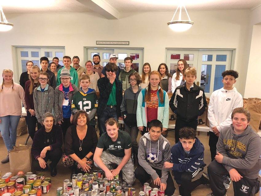 Youth from Dryden's faith community spend their Sunday morning sorting food for 170 Thanksgiving meal baskets to share with community members in need.