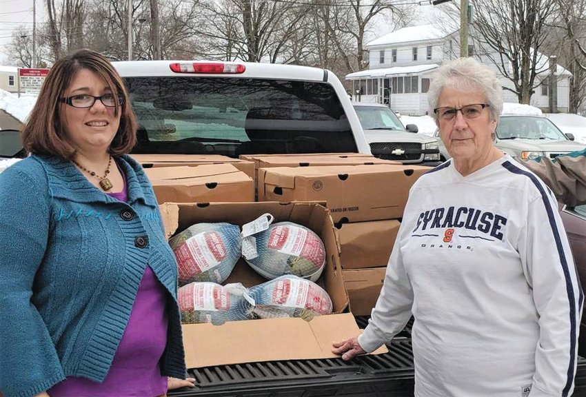 """Jess Stone, left, who will become the new Groton Food Providers food pantry coordinator Jan. 1, 2019 and Donna Bernhardt, right, outgoing coordinator, as they prepare to unload turkeys for the GFP's annual """"Thanksgiving Day Meal Giveaway."""""""