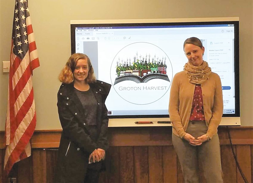 Zoe Barclay (left) and her graphics design teacher, Amber Novack Landers (right) presented Barclay's winning logo for Groton HARVEST at a Groton Board of Education meeting.