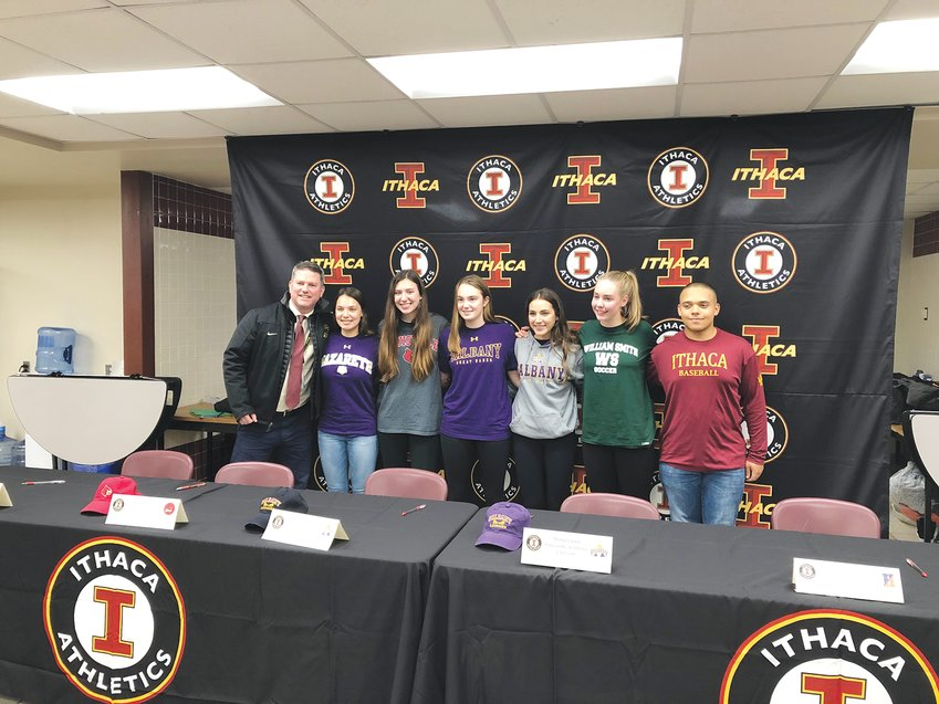 From left to right: IHS Principal Jason Trumble, Reed Baker, Kiely Howe, Julianna Saggese, Maria Vieira, Seneca Blakely-Armitage, Derrick Tomberelli, at their letter-signing event on Nov. 27.