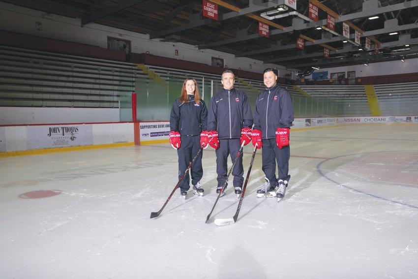 From right to left: Assistant coach Edith Racine, Dough Derraugh, assistant coach Dean Jackson.
