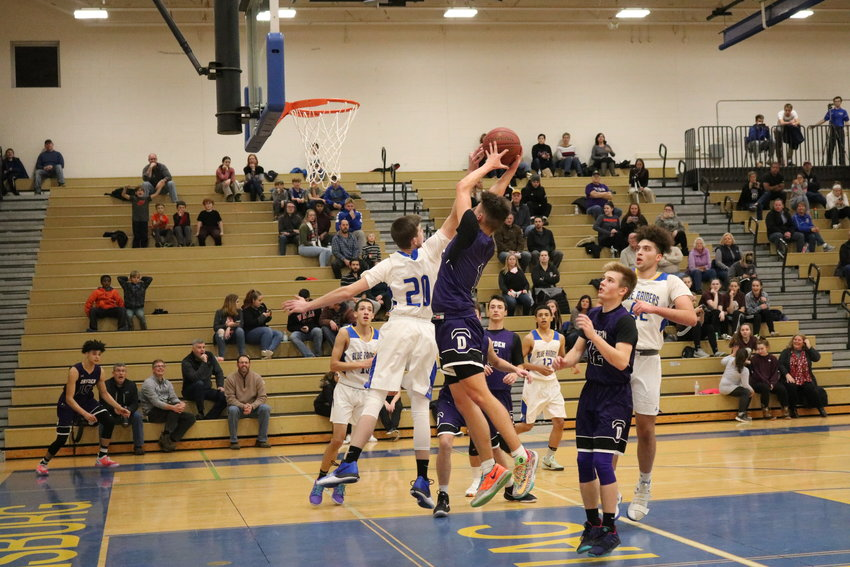 The Trumansburg Blue Raiders have undergone a challenging early-season schedule in their quest to get back to winning ways. Jordan Miller, 20, blocks a shot in the early season loss to Dryden.