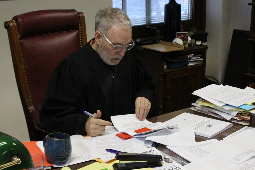 Judge John C. Rowley has to plan his schedule four months ahead of time in 15-minute increments because his caseload tops 300.