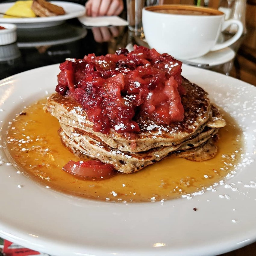 The daily special pancakes often feature a local fruit compote, such as these pecan meal buttermilk pancakes topped with a cranberry and apple compote and NYS maple syrup.