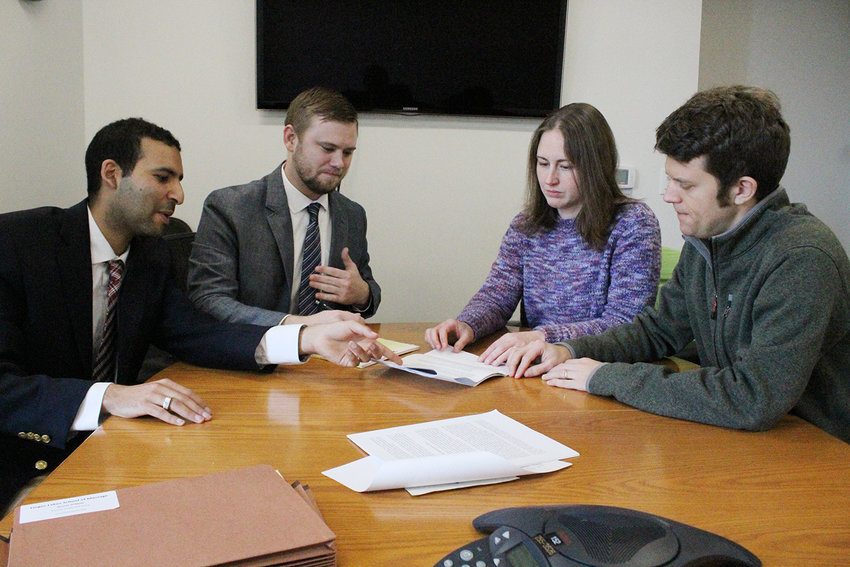 Kate Goldswer and her husband Gabriel Hoff (third and fourth from the left) are two of the seven charging parties who filed complaints against FLSM. With help from the Tompkins County Worker's Center, they were connected to Anthony Wassef and Kolby Boyd (first and second from left) from the Cornell Labor Law Clinic.