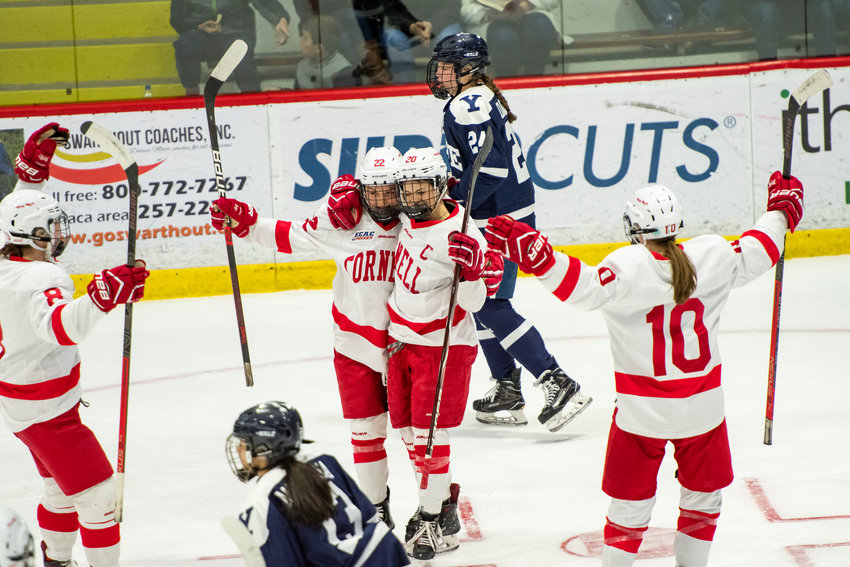 Cornell captain Kristen O'Neill celebrates with her teammates after scoring during the Big Red's 4-0 win over Yale on Saturday. The Big Red are looking to capture the top spot in the ECAC standings with one weekend left in the regular season.