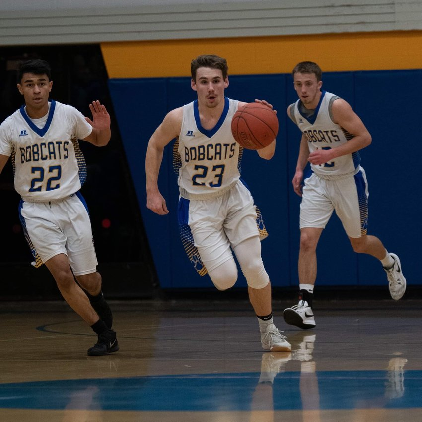 Above: Garrett Bell leads the pack of Langston Hopkins and Luke Winslow as the Lansing Bobcats took on the Senecas of Watkins Glen. The Bobcats advanved to the Section IV semifinals with a 56-51 win.