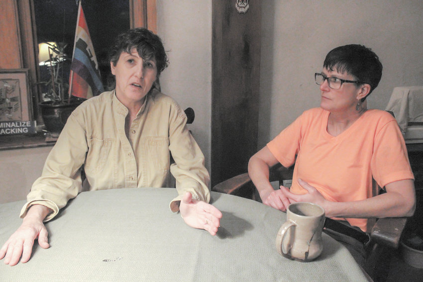 Joanne Cipolla-Dennis, left, and her wife, Deborah Cipolla-Dennis, at their home in Dryden. Joanne, a well-known activist in the area, is suing the county on the argument that the legislature and several of its members violated her First Amendment rights.